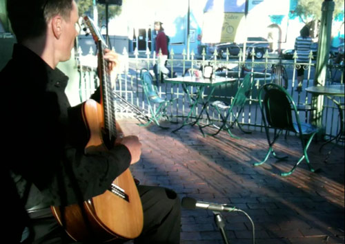 Robert Bekkers gives solo guitar concert outside a restaurant in Tucson, February 2011