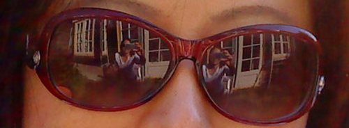 Reflection of Anne Ku in friend's sun glasses in May 2010