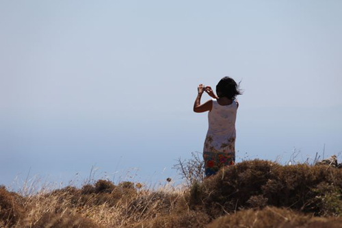 Anne trying to take a picture of the panoramic view above Paleochora, Crete