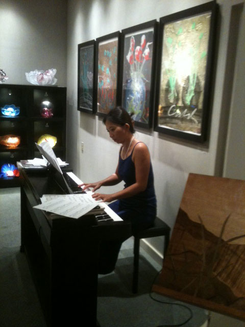 Live piano music at artist reception at the NaPua Gallery in the Grand Wailea